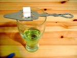 view of large sugar cube over absinthe