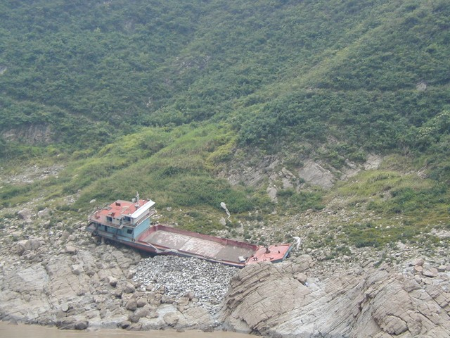 Stranded vessel from flood week prior