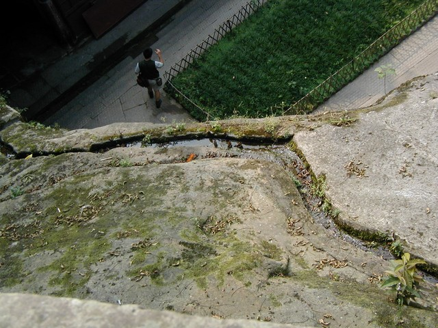 Gazing down into the courtyard below the cliff carvings