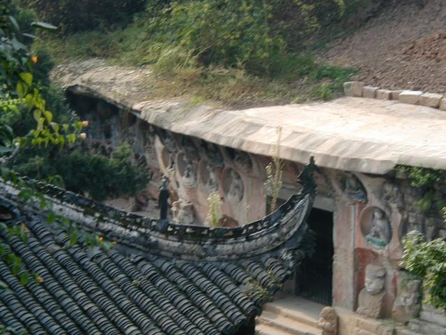 Gaze behind the roof towards carvings below