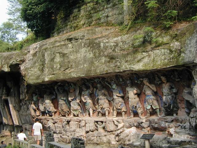 Celestial guardians under cliff near entrance