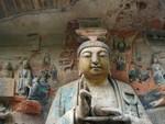 Smiling buddha gazing at visitors