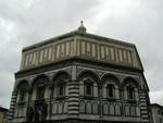 marble facade of building facing Duomo