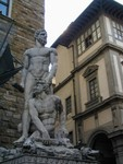 statuary next to David replica at edge of Uffizi