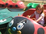 Ella driving the ladybug