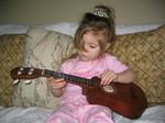 Ella plays the ukelele