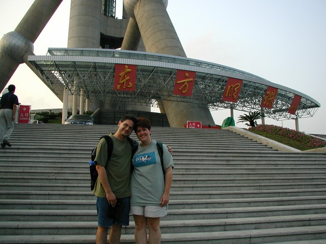 Joe & Ren on the steps at the base of the Oriental Pearl TV Tower