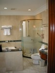Marble tub and shower at the Peace Hotel