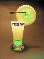 Pernod with a slice of lemon