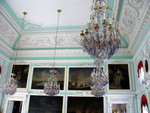 Portraits and chandeliers in the Throne Room
