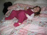 Ella laughing on the quilt