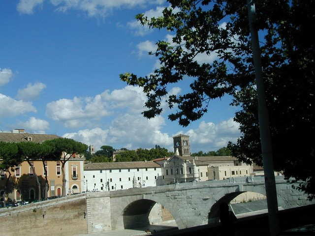 Bell tower behind Ponte Cestio bridge