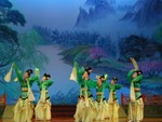 Green costumes with ribbon-like sleeves