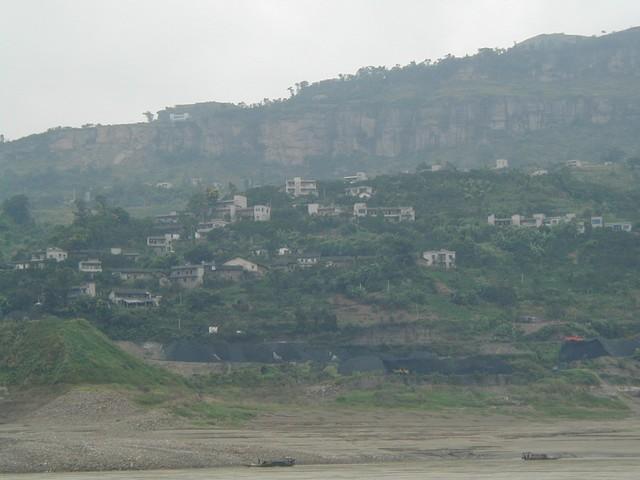 Small houses dotting the Yangtze River's edge