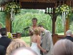 Brian kisses his bride Sue