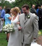 Mrs & Mr Arsenault walk back down the aisle