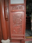 Carved red lacquer door inset