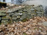 rock wall near basement