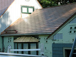 the textures of roof and siding work well together