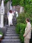 Joe leads Ren down the stairs towards ET