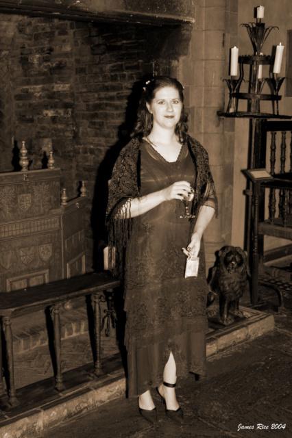 Janine near the fireplace